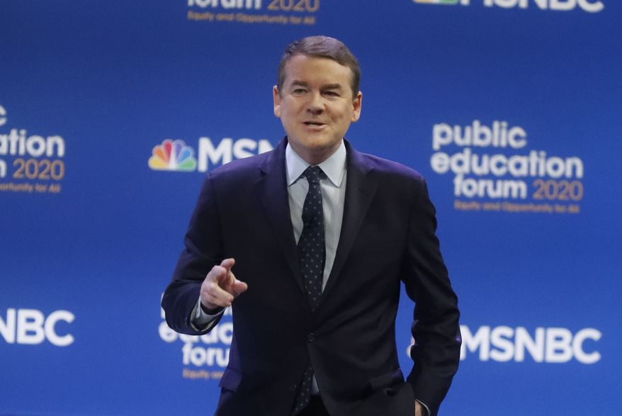 Democratic presidential candidate Sen. Michael Bennet, D-Colo., one of seven scheduled Democratic candidates participating in a public education forum, gives an opening statement, Saturday, Dec. 14, 2019, in Pittsburgh. Topics at the event planned for discussion ranged from student services and special education to education equity and justice issues. (AP Photo/Keith Srakocic)