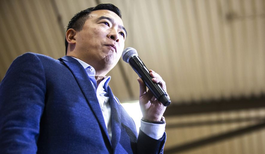 Andrew Yang speaks during a campaign rally at South East Junior High School, Saturday, Dec. 14, 2019, in Iowa City, Iowa. (Joseph Cress/Iowa City Press-Citizen via AP)