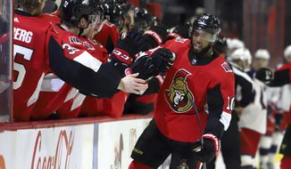 Ottawa Senators left wing Anthony Duclair (10) celebrates with teammates after scoring against the Columbus Blue Jackets during the first period of an NHL hockey game in Ottawa, Saturday, Dec. 14, 2019. (Fred Chartrand/The Canadian Press via AP)
