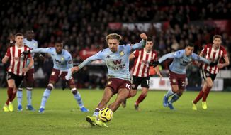 Aston Villa's Jack Grealish misses from the penalty spot during the English Premier League soccer match between Sheffield United and Aston Villa, at Bramall Lane, in Sheffield, England, Saturday, Dec. 14, 2019. (Mike Egerton/PA via AP)