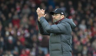 Liverpool's manager Jurgen Klopp greets fans after the English Premier League soccer match between Liverpool and Watford at Anfield stadium in Liverpool, England, Saturday, Dec. 14, 2019. (AP Photo/Rui Vieira)