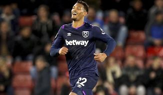 West Ham United's Sebastien Haller celebrates scoring his sides first goal against Southampton during their English Premier League soccer match at St Mary's Stadium in Southampton, England, Saturday Dec. 14, 2019. (Steven Paston/PA via AP)
