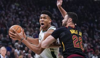 Milwaukee Bucks' Giannis Antetokounmpo drives past Cleveland Cavaliers' Larry Nance Jr. during the first half of an NBA basketball game Saturday, Dec. 14, 2019, in Milwaukee. (AP Photo/Morry Gash)