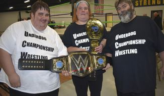 Hillary Gavan/Beloit Daily News Beloiter Shane Schultz along with Joann Calzada and David Reed are the owners of Underdog Championship Wrestling in Rockford, Illinois. Their first event was on Oct. 13 with another event set for Dec. 14.  (Hillary Gavan/The Beloit Daily News via AP)