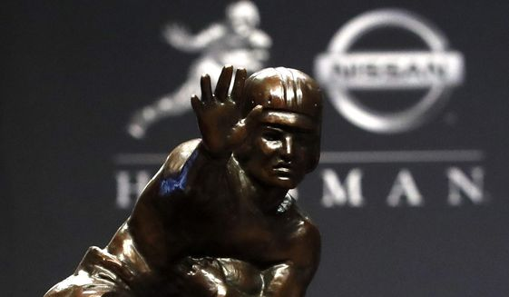 The Heisman Trophy appears on display during a news conference before the Heisman Trophy ceremony, Saturday, Dec. 14, 2019, in New York. (AP Photo/Jason Szenes) **FILE**
