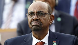 In this July 9, 2018, file photo, Sudan's President Omar al-Bashir attends a ceremony for Turkey's President Recep Tayyip Erdogan, at the Presidential Palace in Ankara, Turkey. On Saturday, Dec. 14, 2019, a Sudan court convicted al-Bashir of money laundering, sentences him to two years in a rehabilitation facility. (AP Photo/Burhan Ozbilici, File)