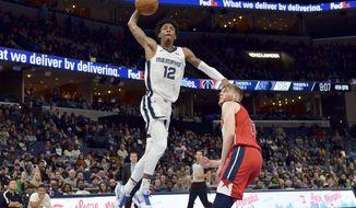 Memphis Grizzlies guard Ja Morant (12) shoots against Washington Wizards forward Davis Bertans in the second half of an NBA basketball game Saturday, Dec. 14, 2019, in Memphis, Tenn. (AP Photo/Brandon Dill) ** FILE **