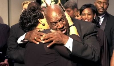 "James Robert ""Radio"" Kennedy hugs T.L. Hanna teacher Vinnie Dill  after he arrived at a screening of the movie ""Radio,"" based on his life, Thursday, Oct. 23, 2003, in Anderson, S.C. (AP Photo/Mary Ann Chastain)"