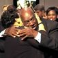 """James Robert """"Radio"""" Kennedy hugs T.L. Hanna teacher Vinnie Dill  after he arrived at a screening of the movie """"Radio,"""" based on his life, Thursday, Oct. 23, 2003, in Anderson, S.C. (AP Photo/Mary Ann Chastain)"""
