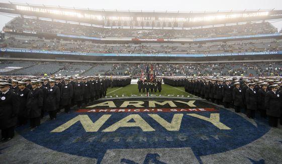 Navy midshipmen march before an NCAA college football game against Army, Saturday, Dec. 14, 2019, in Philadelphia. (AP Photo/Matt Slocum)  **FILE**