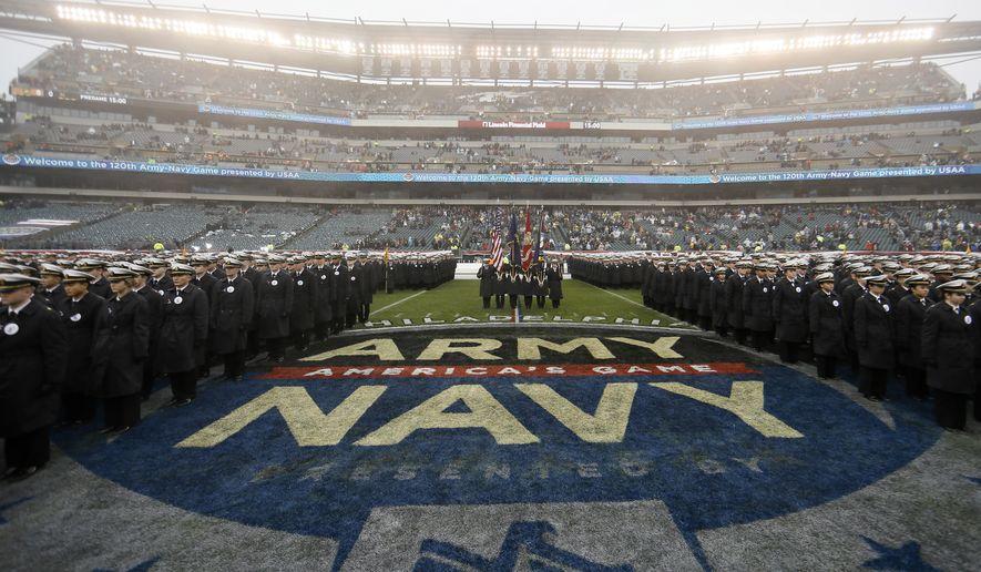 Navy midshipmen march before an NCAA college football game against Army, Saturday, Dec. 14, 2019, in Philadelphia. (AP Photo/Matt Slocum)