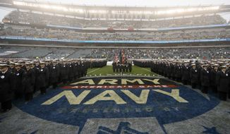 Navy midshipmen march before an NCAA college football game against Army, Saturday, Dec. 14, 2019, in Philadelphia. (AP Photo/Matt Slocum)