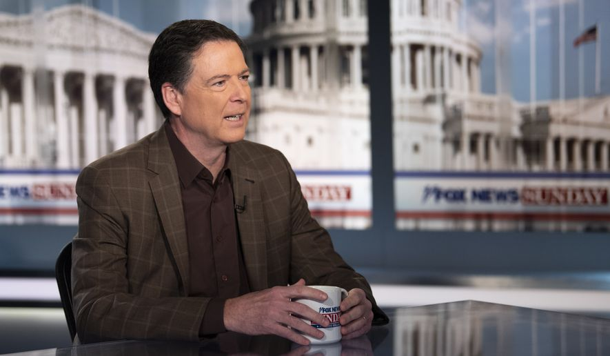 "Former FBI Director James Comey talks with ""Fox News Sunday"" anchor Chris Wallace, Sunday morning, Dec. 15, 2019, in Washington. (AP Photo/Kevin Wolf)"