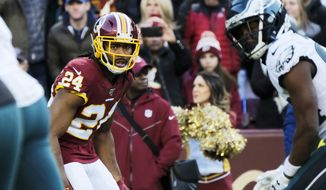 Washington Redskins cornerback Josh Norman (24) looks across the line of scrimmage during an NFL football game against the Philadelphia Eagles, Sunday, Dec. 15, 2019, in Landover, Md. (AP Photo/Mark Tenally) ** FILE **