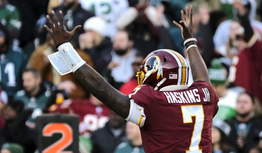 Redskins quarterback Dwayne Haskins celebrates during an NFL football game between the Philadelphia Eagles and Washington Redskins, Sunday, Dec. 15, 2019, in Landover, Md. (AP Photo/Mark Tenally)
