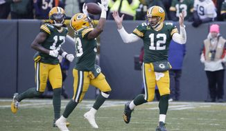 Green Bay Packers' Aaron Jones celebrates his touchdown run with quarterback Aaron Rodgers during the second half of an NFL football game against the Chicago Bears Sunday, Dec. 15, 2019, in Green Bay, Wis. (AP Photo/Mike Roemer)