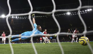 Arsenal's goalkeeper Bernd Leno, left, fails to save the ball as Manchester City's Raheem Sterling, third right, scores his side's second goal during the English Premier League soccer match between Arsenal and Manchester City, at the Emirates Stadium in London, Sunday, Dec. 15, 2019. (AP Photo/Ian Walton)