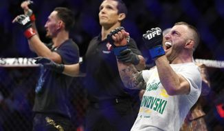 Alexander Volkanovski celebrates after defeating Max Holloway in a mixed martial arts featherweight championship bout at UFC 245, Saturday, Dec. 14, 2019, in Las Vegas. (AP Photo/John Locher)