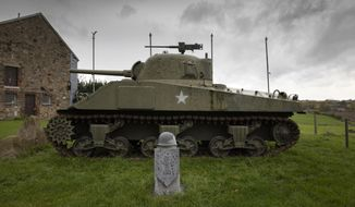 In this photo taken on Thursday, Nov. 7, 2019, A U.S. Army World War II Sherman tank sits on the hillside outside the Remember Museum 39-45 in Thimister-Clermont, Belgium. In the bucolic, verdant hills which were once among the worst killing grounds of WWII Marcel and Mathilde Schmetz have shared coffee and cake with countless veterans, telling stories that span generations. Veterans of the WWII Battle of the Bulge are heading back to mark, perhaps the greatest battle in U.S. military history, when 75-years ago Hitler launched a desperate attack deep through the front lines in Belgium and Luxembourg to be thwarted by U.S. forces. (AP Photo/Virginia Mayo