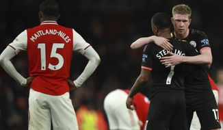 Manchester City's Kevin De Bruyne celebrates with Manchester City's Raheem Sterling at the end of the English Premier League soccer match between Arsenal and Manchester City, at the Emirates Stadium in London, Sunday, Dec. 15, 2019. (AP Photo/Ian Walton)