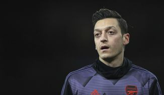 Arsenal's Mesut Ozil warms up prior the English Premier League soccer match between Arsenal and Manchester City, at the Emirates Stadium in London, Sunday, Dec. 15, 2019. (AP Photo/Ian Walton)