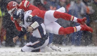 Kansas City Chiefs defensive end Alex Okafor (97) sacks Denver Broncos quarterback Drew Lock (3) during the first half of an NFL football game in Kansas City, Mo., Sunday, Dec. 15, 2019. (AP Photo/Charlie Riedel)