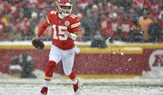 Kansas City Chiefs quarterback Patrick Mahomes (15) carries the ball during the first half of an NFL football game against the Denver Broncos in Kansas City, Mo., Sunday, Dec. 15, 2019. (AP Photo/Ed Zurga)