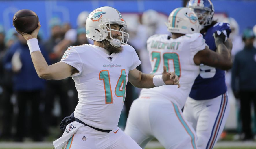 Miami Dolphins quarterback Ryan Fitzpatrick (14) passes against the New York Giants during the first quarter of an NFL football game, Sunday, Dec. 15, 2019, in East Rutherford, N.J. (AP Photo/Seth Wenig)