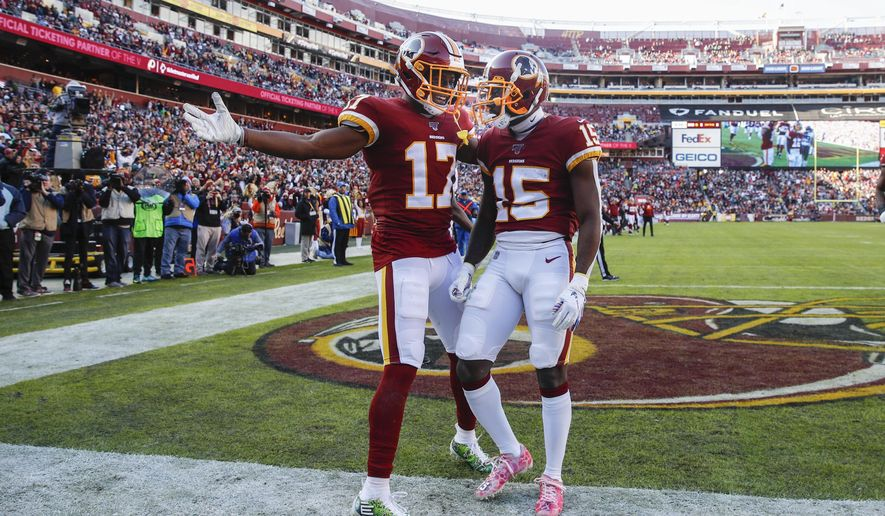 Washington Redskins wide receiver Steven Sims (15) celebrates his touchdown with teammate wide receiver Terry McLaurin (17) in the first half of an NFL football game against the Philadelphia Eagles, Sunday, Dec. 15, 2019, in Landover, Md. (AP Photo/Patrick Semansky)