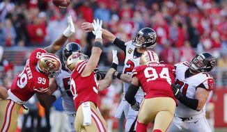 Atlanta Falcons quarterback Matt Ryan (2) passes as San Francisco 49ers defensive tackle DeForest Buckner (99), defensive end Nick Bosa (97) and defensive end Solomon Thomas (94) apply pressure during the first half of an NFL football game in Santa Clara, Calif., Sunday, Dec. 15, 2019. (AP Photo/John Hefti)