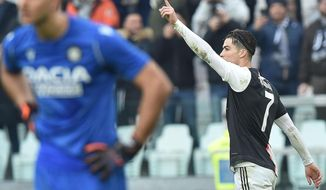 Juventus' Cristiano Ronaldo, right, celebrates after scoring his second goal during the Italian Serie A soccer match between Juventus and Udinese at the Allianz Stadium in Turin, Italy, Sunday, Dec. 15, 2019. (Alessandro Di Marco/ANSA via AP)
