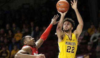 Minnesota guard Gabe Kalscheur (22) shoots over Ohio State guard D.J. Carton in the first half of an NCAA basketball game Sunday, Dec. 15, 2019, in Minneapolis. (AP Photo/Andy Clayton-King)