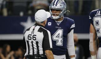 Dallas Cowboys quarterback Dak Prescott (4) talks with referee Walt Anderson (66) in the first quarter of an NFL football game against the Los Angeles Rams in Arlington, Texas, Sunday, Dec. 15, 2019. (AP Photo/Michael Ainsworth)