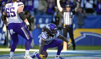 Minnesota Vikings running back Mike Boone, right, reacts with teammates after scoring a touchdown during the second half of an NFL football game against the Los Angeles Chargers, Sunday, Dec. 15, 2019, in Carson, Calif. (AP Photo/Kelvin Kuo)