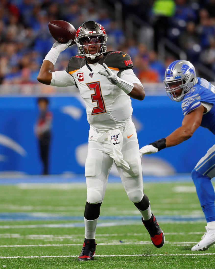 The Buccaneers' Jameis Winston on Sunday became the first quarterback to pass for at least 450 yards in back-to-back regular season games in the NFL. (ASSOCIATED PRESS)