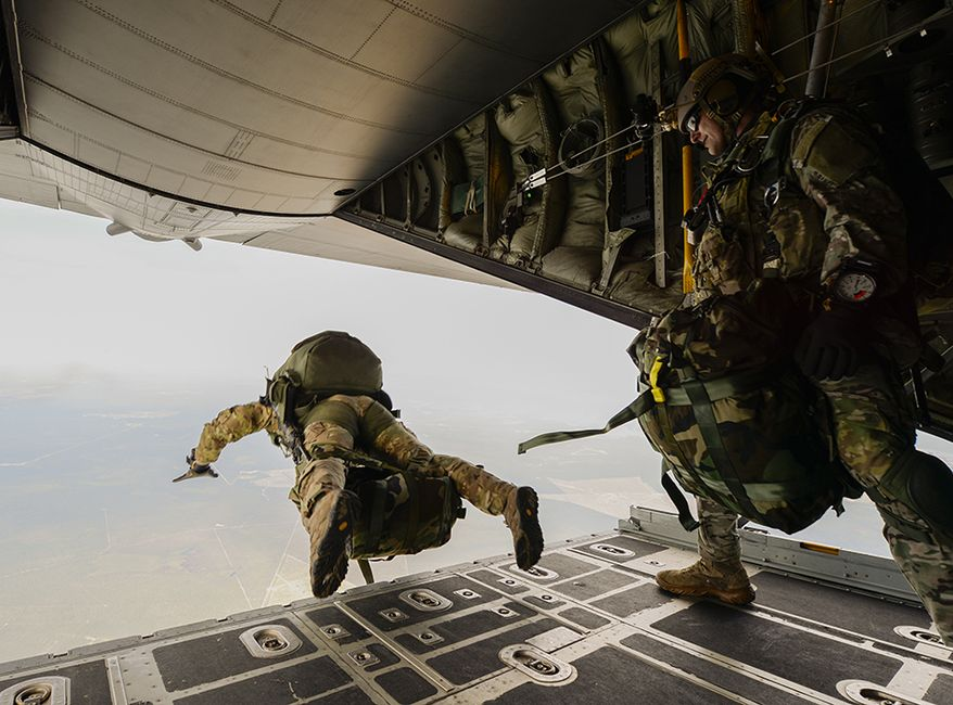 U.S. Army Green Berets from the 7th Special Forces Group jump out of a C-130H3 Hercules for Emerald Warrior at Hurlburt Field, Fla., April 22, 2015. Emerald Warrior is the Department of Defense's only irregular warfare exercise, allowing joint and combined partners to train together and prepare for real-world contingency operations. (U.S. Air Force photo by Tech. Sgt. Joshua J. Garcia /Released)  ** FILE **