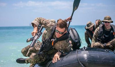 U.S. Army Soldiers attend the 1st Special Warfare Training Group at the U.S. Army John F. Kennedy Special Warfare Center and School, Special Forces Combat Diver Qualification Course to train in amphibious infiltration, June 7, 2018, at Key West Fla. Green Beret Combat Divers are assigned to U.S. Army Special Forces Operational Detachment - Alphas that specialize in maritime operations. (U.S. Army photo)