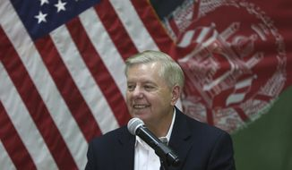 Sen. Lindsey Graham, South Carolina Republican, made a surprise visit Monday to the Resolute Support headquarters in Kabul, Afghanistan, and said President Trump would announce an American troop drawdown this week. (Associated Press)