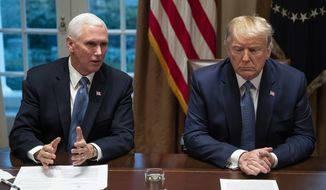 President Donald Trump listens as Vice President Mike Pence speaks during a roundtable with governors on government regulations in the Cabinet Room of the White House, Monday, Dec. 16, 2019, in Washington. (AP Photo/ Evan Vucci)