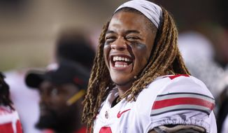 FILE - In this Oct. 18, 2019, file photo, Ohio State defensive end Chase Young laughs on the sidelines during the second half of an NCAA college football game against Northwestern, in Evanston, Ill. Young was selected to The Associated Press All-Am erica team, Monday, Dec. 16, 2019. (AP Photo/Charles Rex Arbogast, File)