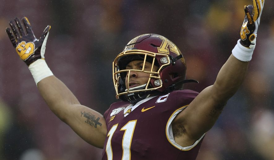 FILE - In this Nov. 30, 2019, file photo. Minnesota defensive back Antoine Winfield Jr. (11) gestures during an NCAA college football game against Wisconsin, in Minneapolis. Winfield was selected to The Associated Press All-America team, Monday, Dec. 16, 2019. (AP Photo/Stacy Bengs, File)