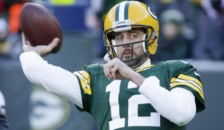 Green Bay Packers' Aaron Rodgers warms up before an NFL football game against the Chicago Bears Sunday, Dec. 15, 2019, in Green Bay, Wis. (AP Photo/Mike Roemer)