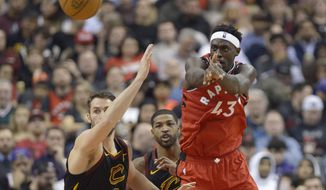 Toronto Raptors forward Pascal Siakam (43) passes the ball past Cleveland Cavaliers forward Kevin Love (0) during first half NBA basketball action in Toronto on Monday, Dec. 16, 2019. (Nathan Denette/The Canadian Press via AP)