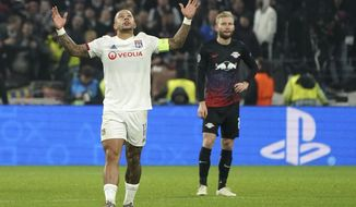 Lyon's Memphis Depay celebrates after he scored a goal during the group G Champions League soccer match between Lyon and RB Leipzig at the Lyon Olympic Stadium in Decines, outside Lyon, France, Tuesday, Dec. 10, 2019. (AP Photo/Laurent Cipriani)