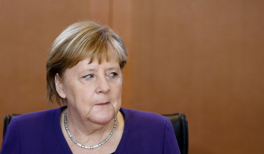 German Chancellor Angela Merkel attends the weekly cabinet meeting of the German government at the chancellery in Berlin, Wednesday, Dec. 11, 2019. (AP Photo/Markus Schreiber)
