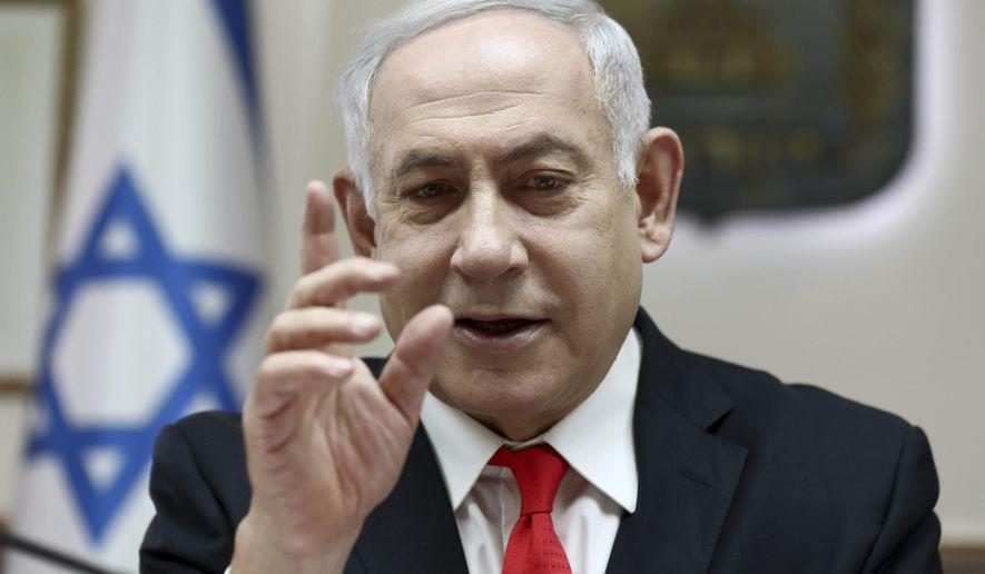 Israeli Prime Minister Benjamin Netanyahu reacts during the weekly cabinet meeting, at his office in Jerusalem, Sunday, Dec. 15, 2019. (Gali Tibbon/Pool via AP)