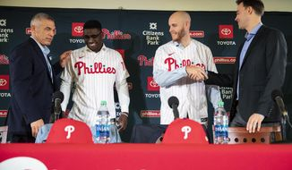 Philadelphia Phillies baseball team members from the left, manager Joe Girardi, players Didi Gregorius and Zack Wheeler, and general manager Matt Klentak take part in a news conference to introduce Gregorius and Wheeler in Philadelphia, Monday, Dec. 16, 2019.  (AP Photo/Matt Rourke)