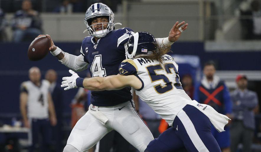 Dallas Cowboys quarterback Dak Prescott (4) passes under pressure from Los Angeles Rams outside linebacker Clay Matthews (52) in the first half of an NFL football game in Arlington, Texas, Sunday, Dec. 15, 2019. (AP Photo/Ron Jenkins)