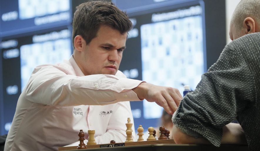 In this photo dated Wednesday, Dec. 26, 2018, Chess World Champion Magnus Carlsen (left) from Norway during a game against Russia's Nikolai Vlassov during the World Rapid and Blitz Chess Championships in St. Petersburg, Russia. (AP Photo/Dmitri Lovetsky) **FILE**