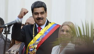 Venezuela's President Nicolas Maduro waves as he arrives at the National Constituent Assembly's building during the celebration rally of the 20th anniversary of the Venezuelan Constitution in Caracas, Venezuela, Sunday, Dec. 15, 2019. (AP Photo/Matias Delacroix) **FILE**